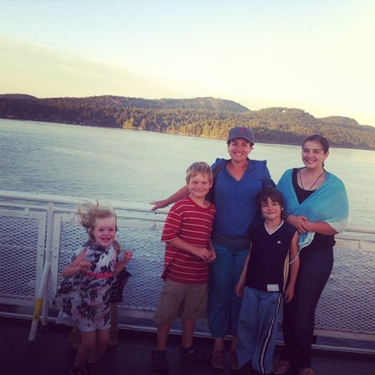 "Group Shot on the ferry. The 4 year old has ""the look""... you know the crazy eyes accompanied by wild energy when they stay up too late and don't have a nap... yep, thats the one..."