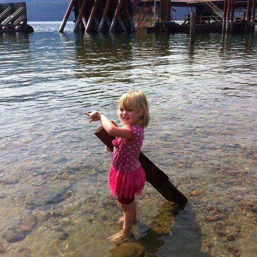 "She insisted this driftwood was her ""surfboard"". We played in the water for an hour waiting for one of our ferries."