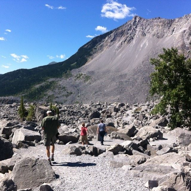 Hiking through the rocks that slid off of Turtle mountain, burying the river, railroad and part of the village below